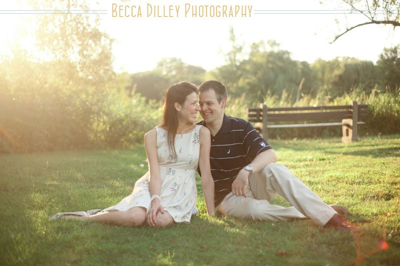 minneapolis couple portraits at lake of the isles sitting on grass
