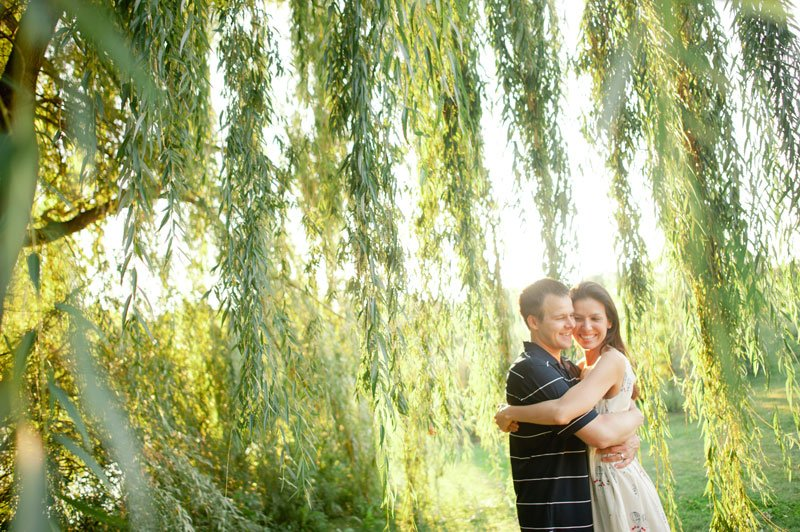 minneapolis couple portraits at lake of the isles with weeping willow tree at sunset
