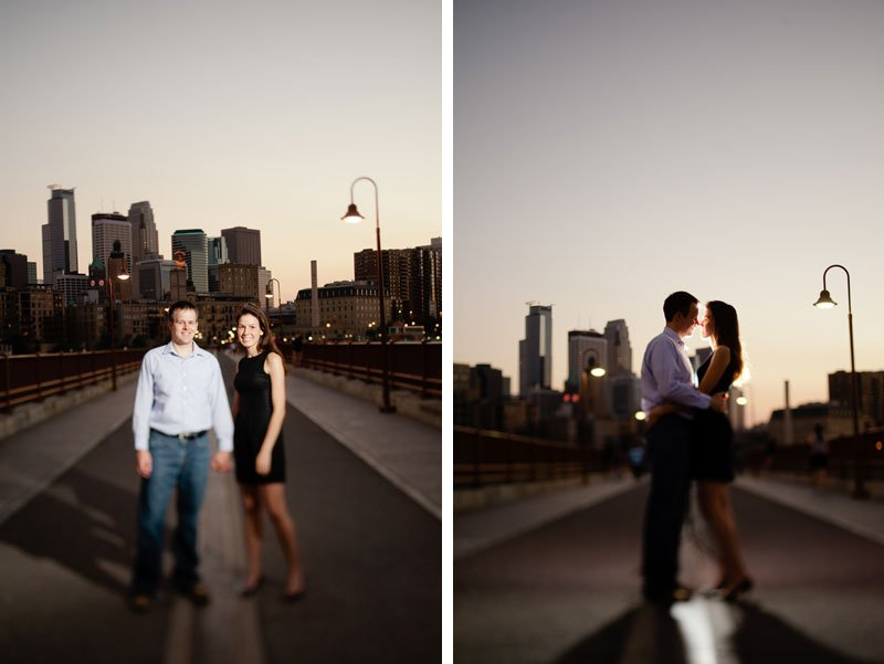 minneapolis couple portraits at stone arch bridge at night with dramatic lighting
