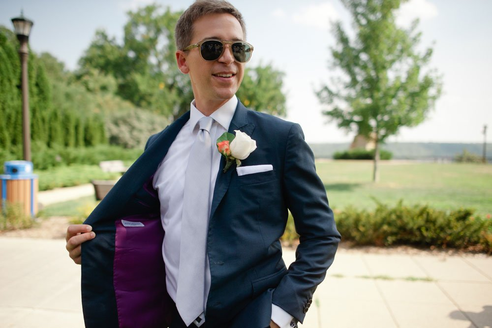 groom with purple suit lining