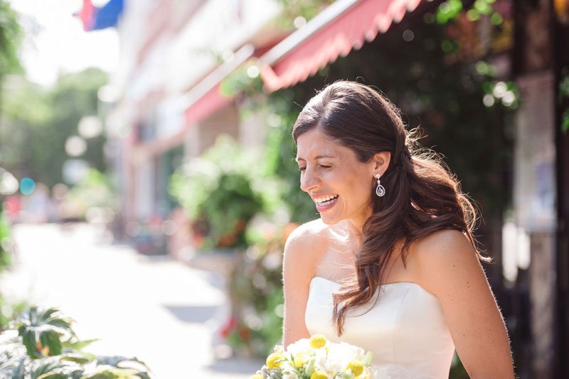 bride laughing outside of loring pasta bar minneapolis