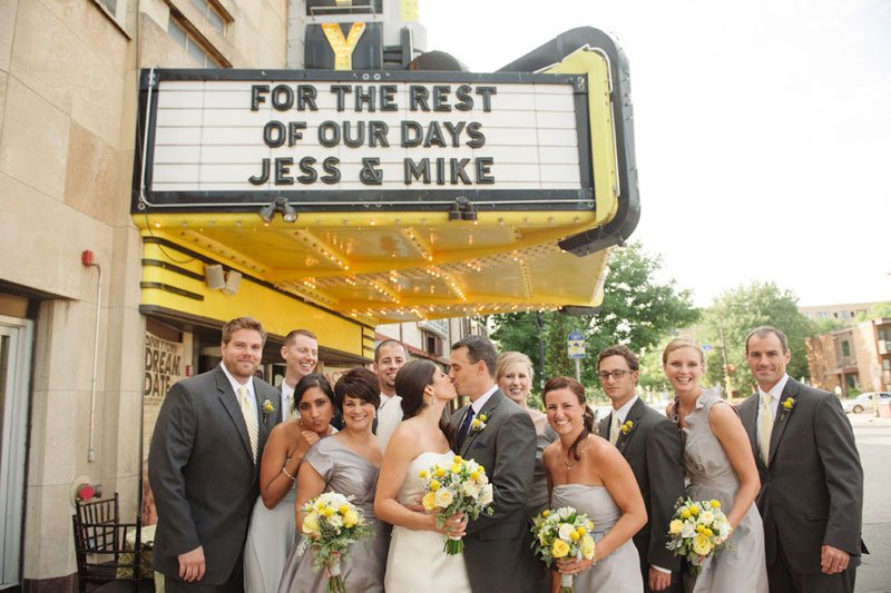 wedding party with theater marquee at varsity theater wedding minneapolis