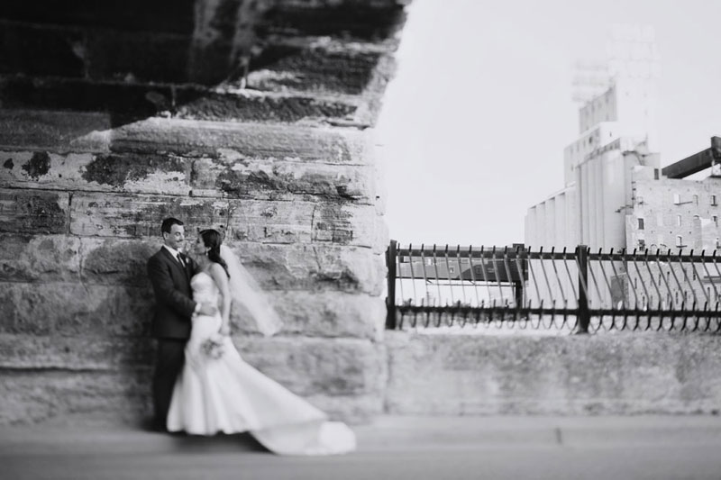bride and groom at stone arch bridge