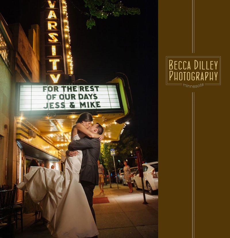bride and groom at night in front of theater marquee at varsity theater wedding minneapolis