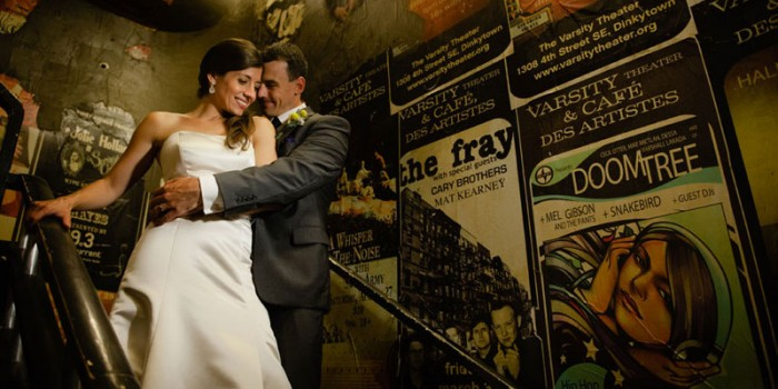 bride and groom with music posters including doomtree at varsity theater wedding minneapolis