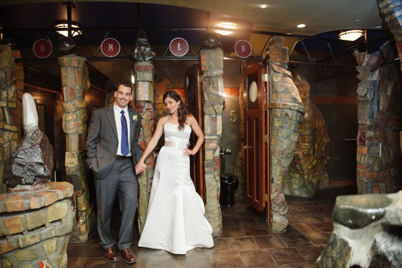 bride and groom in front of bathrooms at varsity theater wedding minneapolis