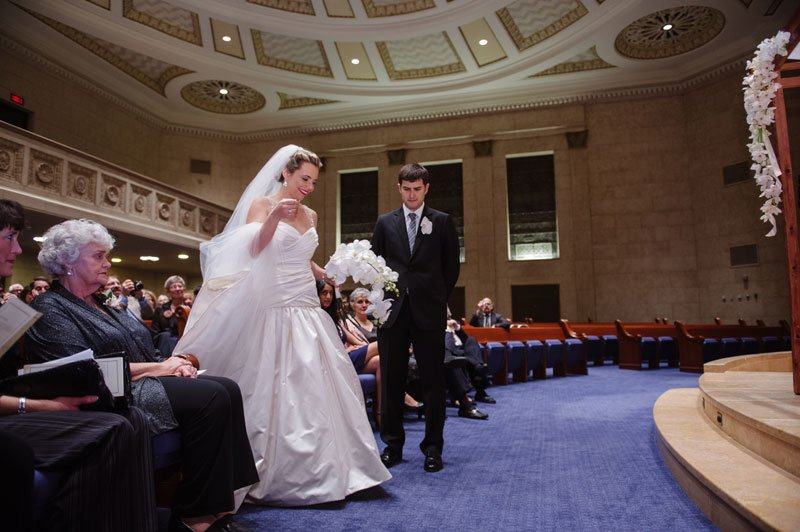 bride walks around groom during Temple Israel Wedding Minneapolis MN