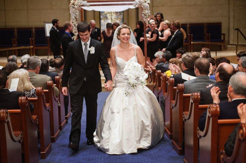 Bride and groom walk down aisle after Temple Israel Wedding Minneapolis MN