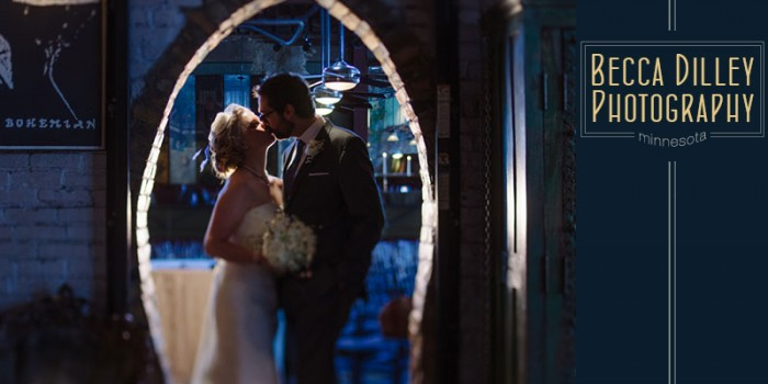 minneapolis wedidng at loriing pasta bar in dinkytown with old brick archway and blue light