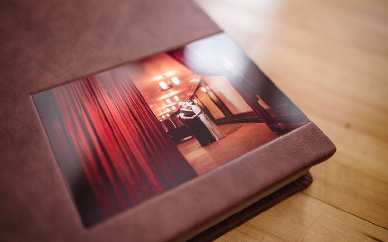 brown leather flush mount album with metal cameo photo