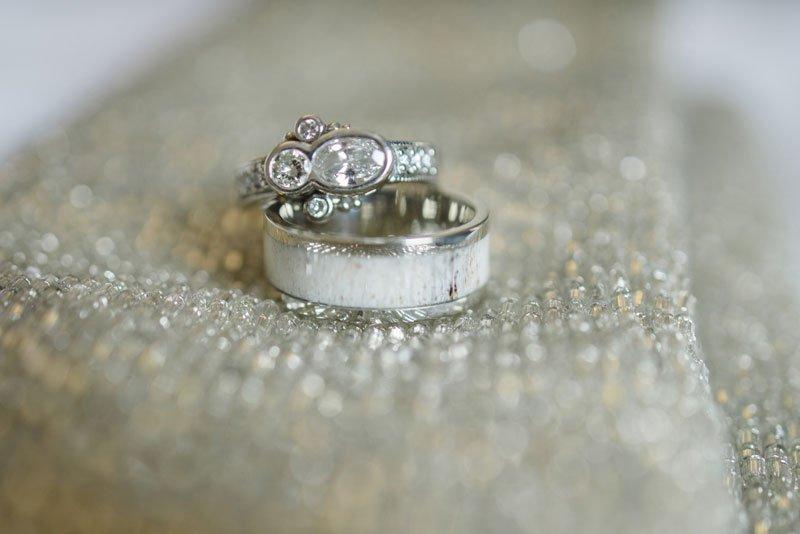 grooms ring made of antler at winter wedding in minneapolis