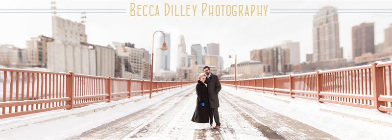 minneapolis wedding at stone arch bridge in winter with bride and groom and snow panorama