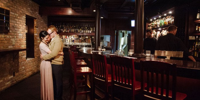 bride and groom at bar of happy gnome for rehearsal dinner st paul mn