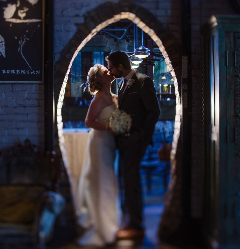 dramatic lighting in blue arch at loring pasta bar wedding minneapolis