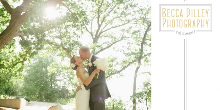 Couple kissing on lakeshore path in Madison for summer wedding