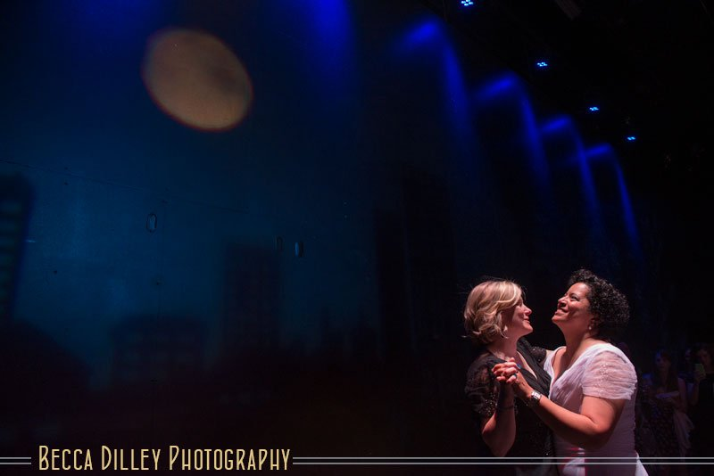 bride and bride dancing at the Guthrie theater
