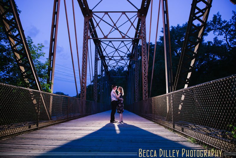 photo of couple on a bridge on nicollet island