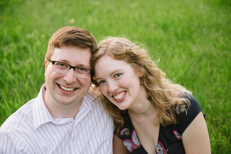 smiling couple with green grass