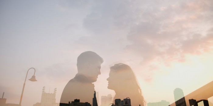 double exposure of engaged couple on stone arch bridge in Minneapolis