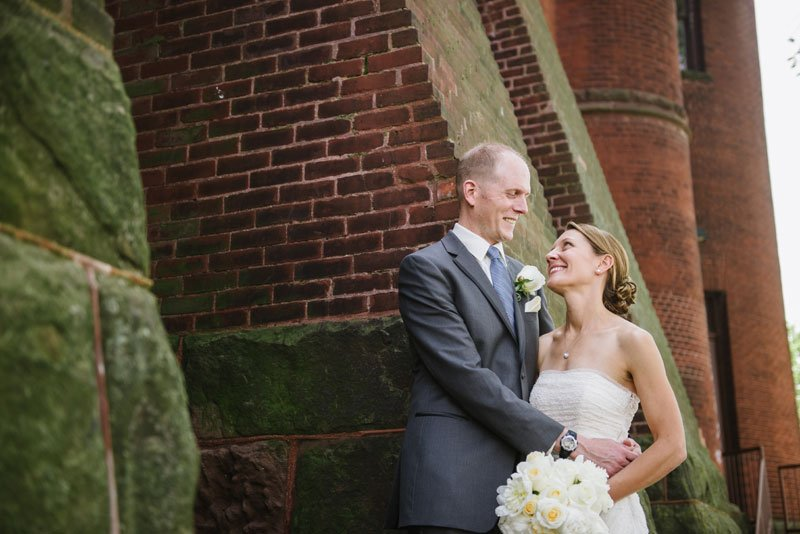 bride and groom outside red gym armory in madison wi