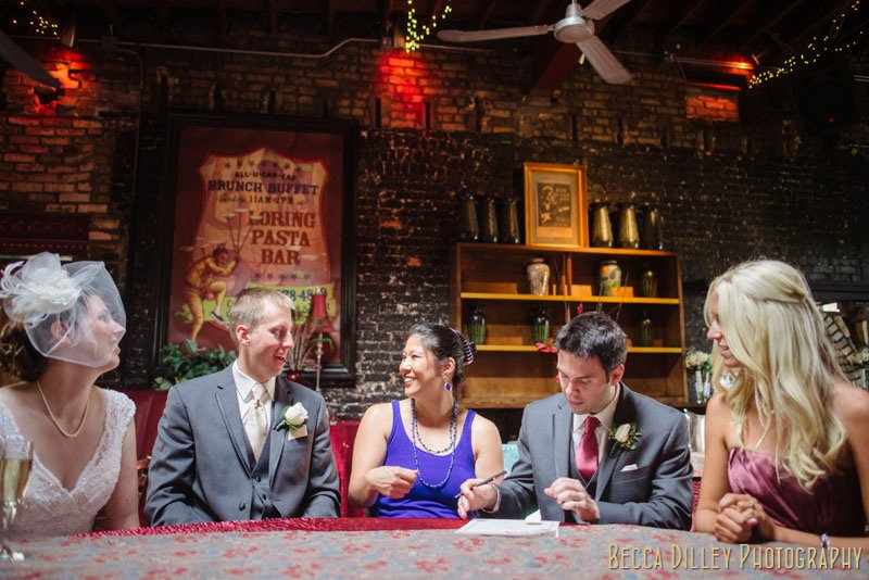 bride and groom sign marriage license at loring pasta bar minneapolis wedding