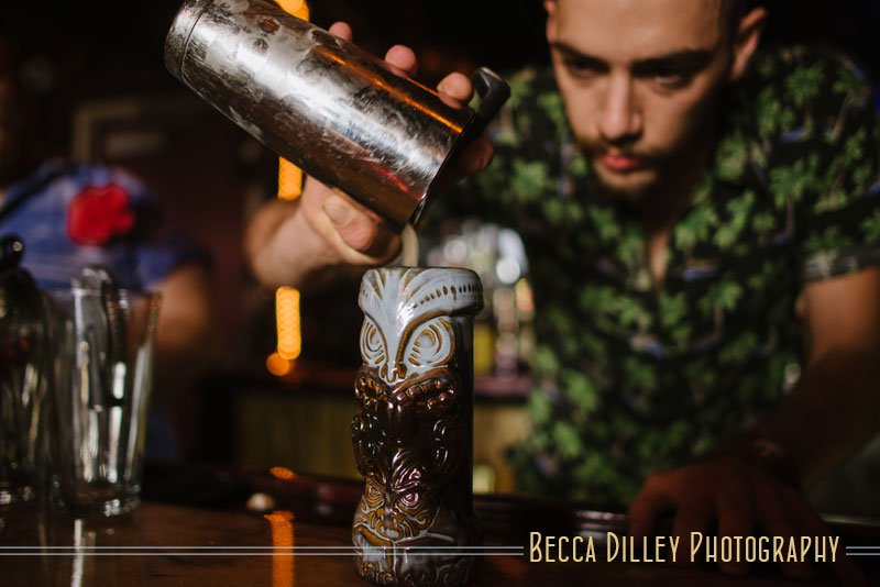 pouring drink into tiki cup