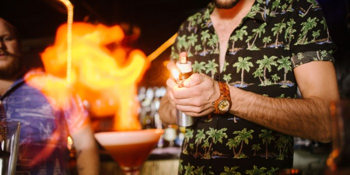 bartender lighting drink on fire
