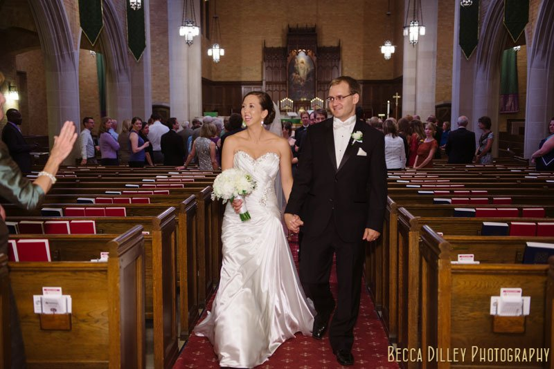 bride and groom walk down aisle at Bethlehem Lutheran Church wedding minneapolis mn