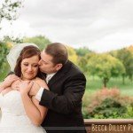 Groom kisses bride in front of golf course at Southview Country Club in St Paul MN