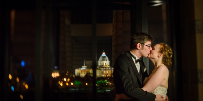 bride and groom at mn history center at night with capitol in background