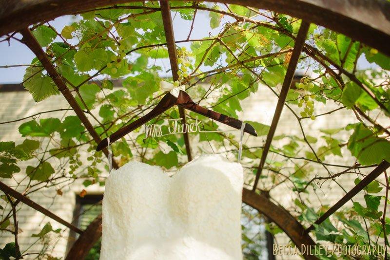 wedding dress hanging outside church