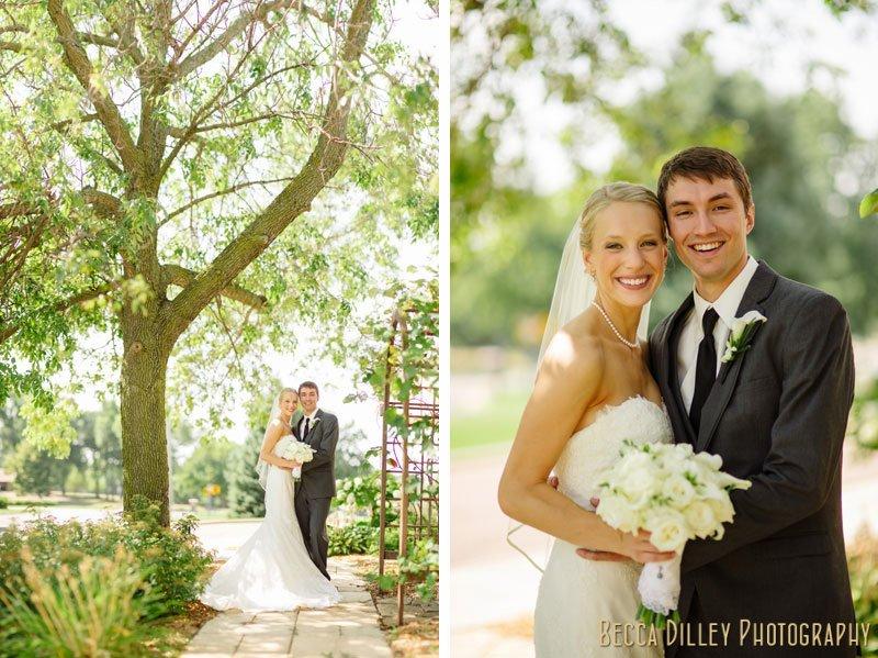 bride and groom under tree at summer wedding