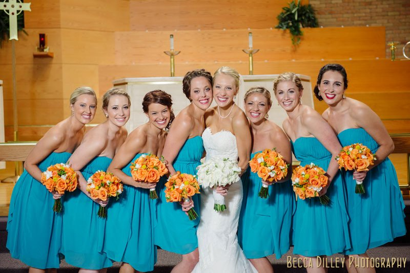 bride with 7 bridesmaids in teal dresses