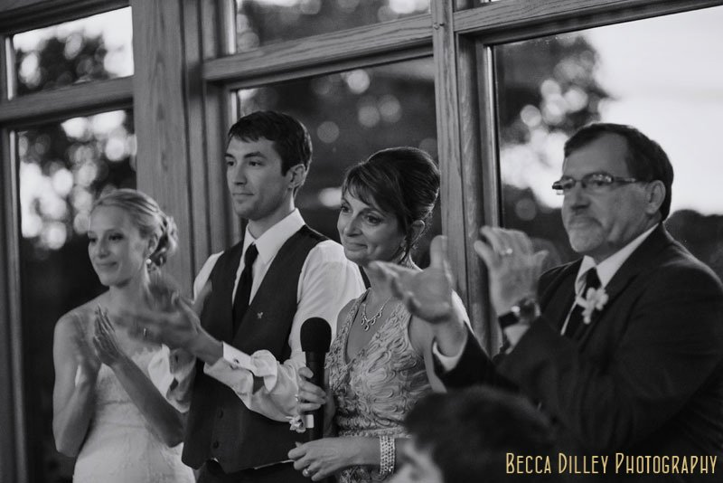 grooms parents give toast at Mendakota Country Club