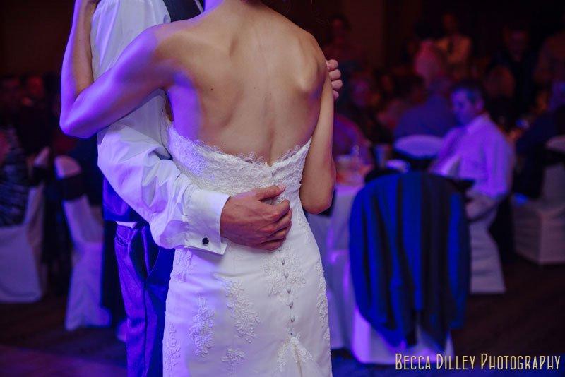 groom holds brides waist at Mendakota Country Club