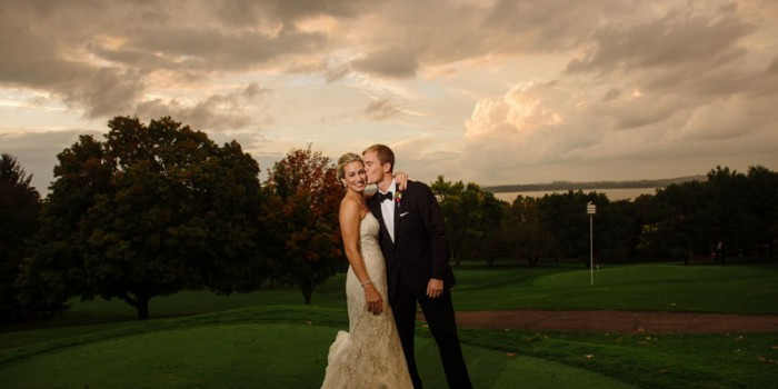 bride and groom with dramatic clouds as sun set at blackhawk country club wedding madison wi