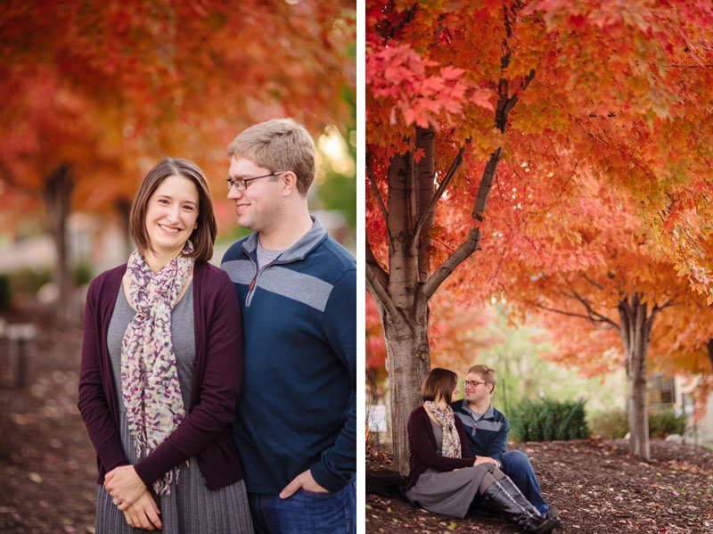 couple with bright orange leaves on trees