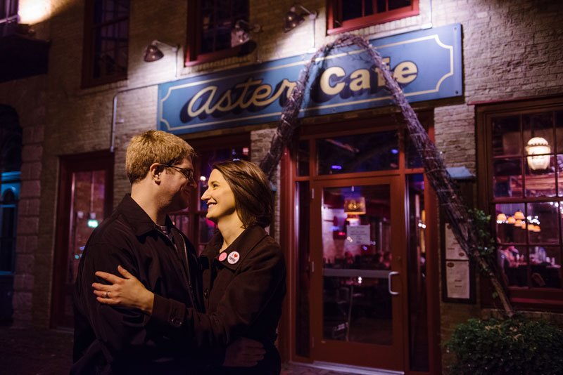 night portrait of couple in front of aster cafe