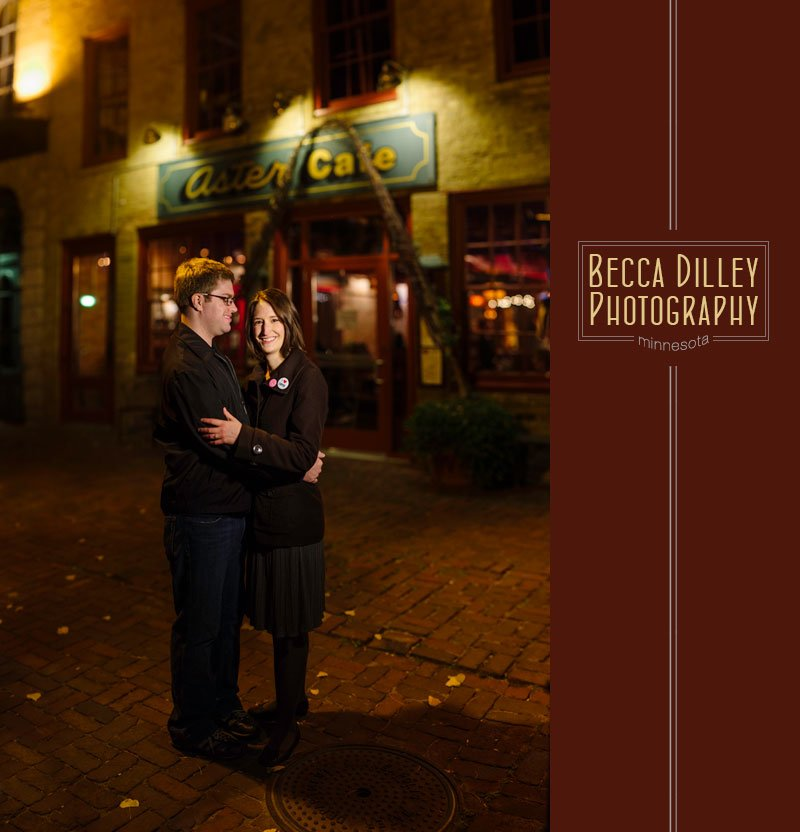 night portrait of couple in front of aster cafe in minneapolis