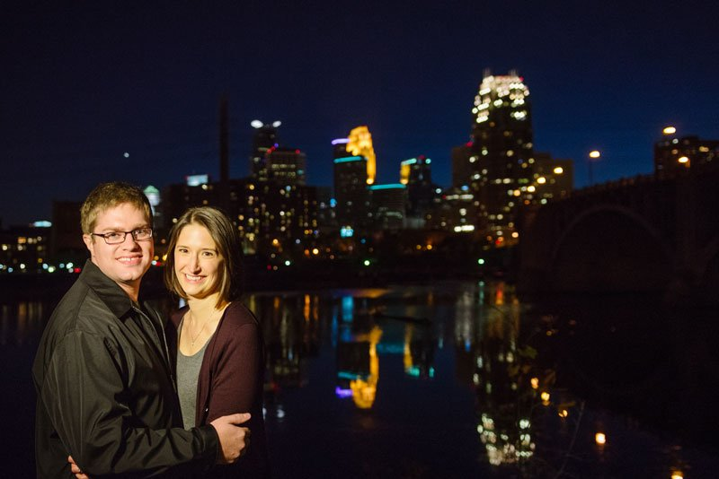 night portrait of couple with minneapolis skyline