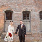 Bride and groom around warehouse district in downtown Minneapolis