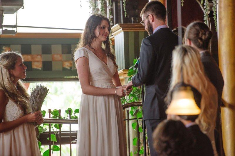 bride and groom exchange vows at loring pasta bar wedding