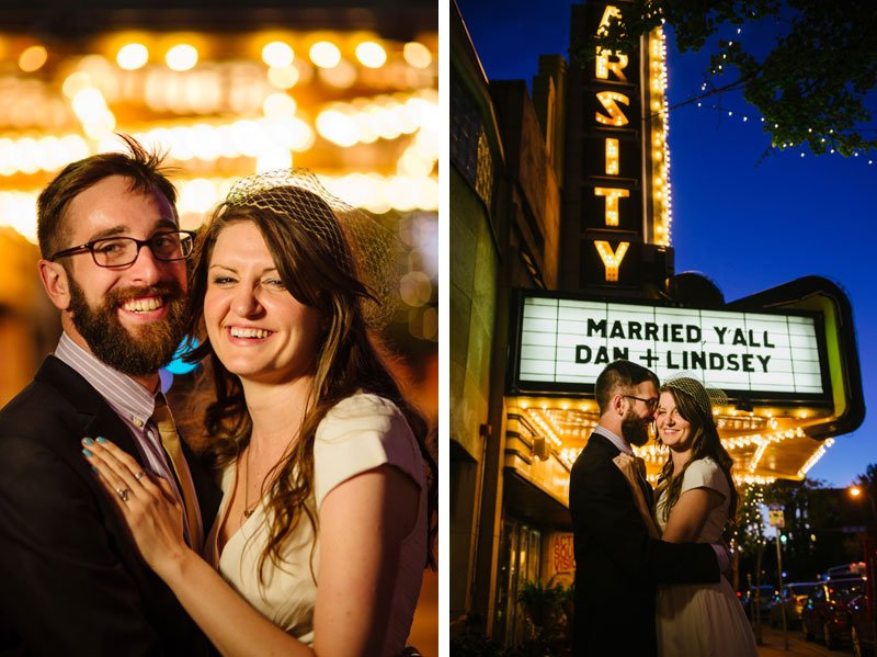 bride and groom in front of marquee at varsity theater at night