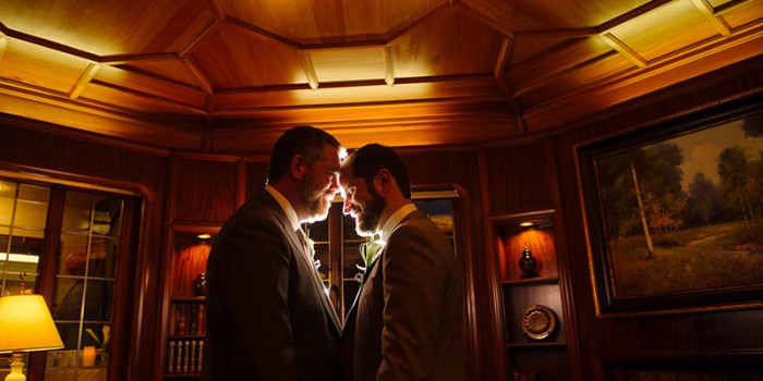 two grooms touch foreheads at St Paul college club mn