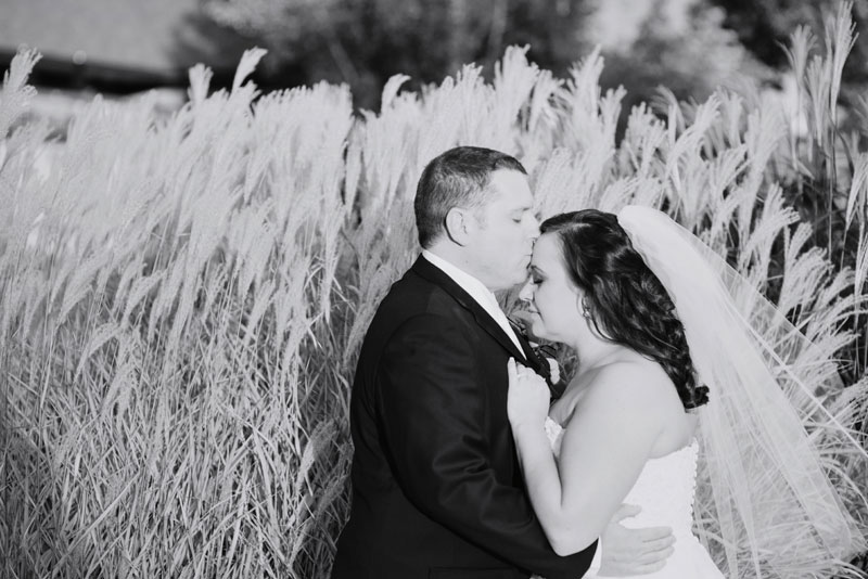 groom kisses brides forhead at southview country club
