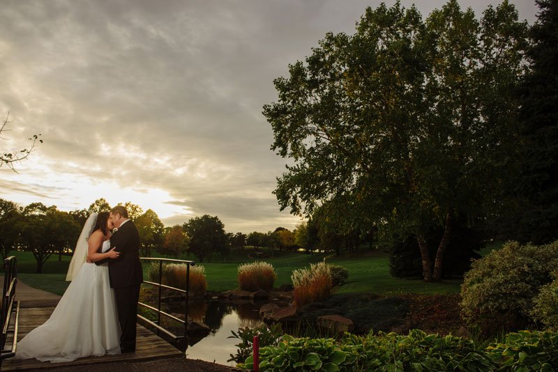 bride and groom with dramatic lighting at dusk t southview country club