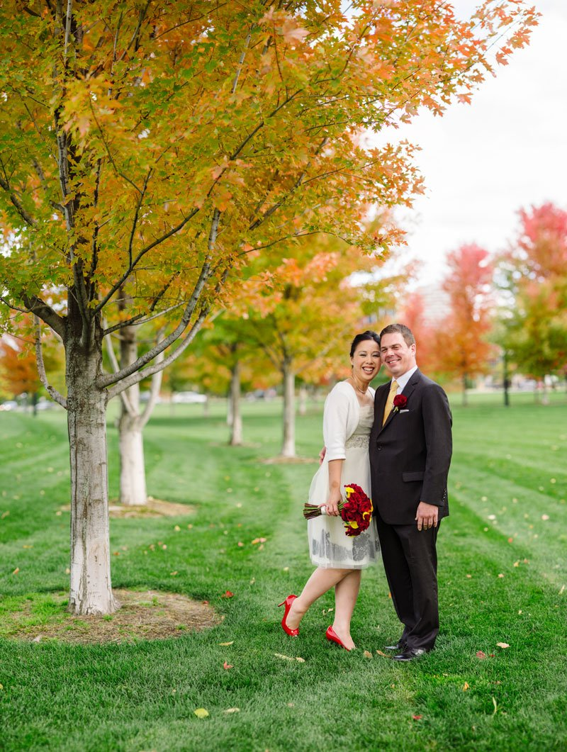 panorama of bride and groom with autumn leaves