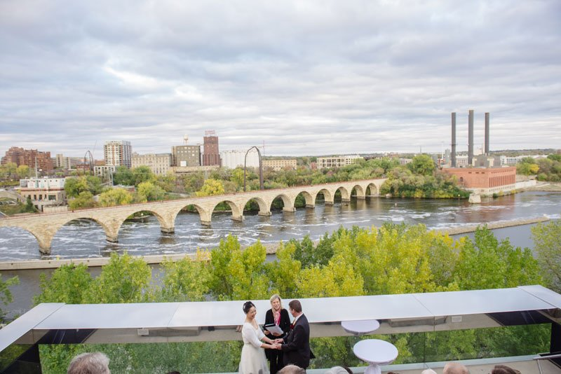 wedding ceremony on endless bridge of guthrie theater minneapolis