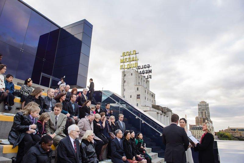 wedding ceremony on endless bridge of guthrie theater minneapolis