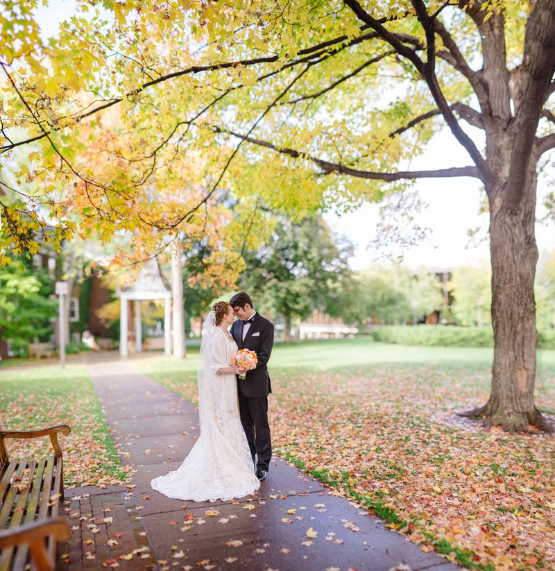 panorama of bride and groom with leaves and rain outside macalester college - mn history center wedding